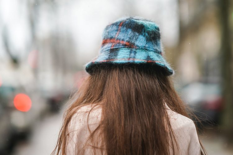 PARIS, FRANCE - FEBRUARY 18: Alba Garavito Torre wears a blue wool striped bob hat from Anthony Peto, on February 18, 2021 in Paris, France. (Photo by Edward Berthelot/Getty Images)