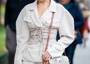 PARIS, FRANCE - SEPTEMBER 26: A guest is seen wearing creme white blazer, corset, hat, Chloe bag outside Chloe during Paris Fashion Week Womenswear Spring Summer 2020 on September 26, 2019 in Paris, France. (Photo by Christian Vierig/Getty Images)