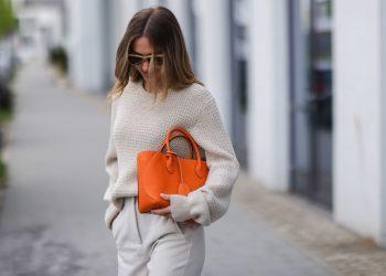 DUSSELDORF, GERMANY - MAY 03: Ann Kathrin Götze wearing beige Ferragamo knit sweater, orange Bonaventura Mia Tote bag and beige Zara pants on May 03, 2021 in Dusseldorf, Germany. (Photo by Jeremy Moeller/Getty Images)