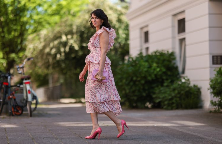 HAMBURG, GERMANY - MAY 31: Anna Wolfers wearing white and pink ruffle dress via Goldig Shop, pink Moschino clutch and pink heels on May 31, 2021 in Hamburg, Germany. (Footage by Photographer/Getty Images) (Photo by Jeremy Moeller/Getty Images)
