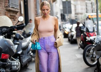 MILAN, ITALY - SEPTEMBER 20: Leonie Hanne seen wearing body, Bottega Veneta metallic mini pouch, pink sheer pants outside the Blumarine show during Milan Fashion Week Spring/Summer 2020 on September 20, 2019 in Milan, Italy. (Photo by Christian Vierig/Getty Images)