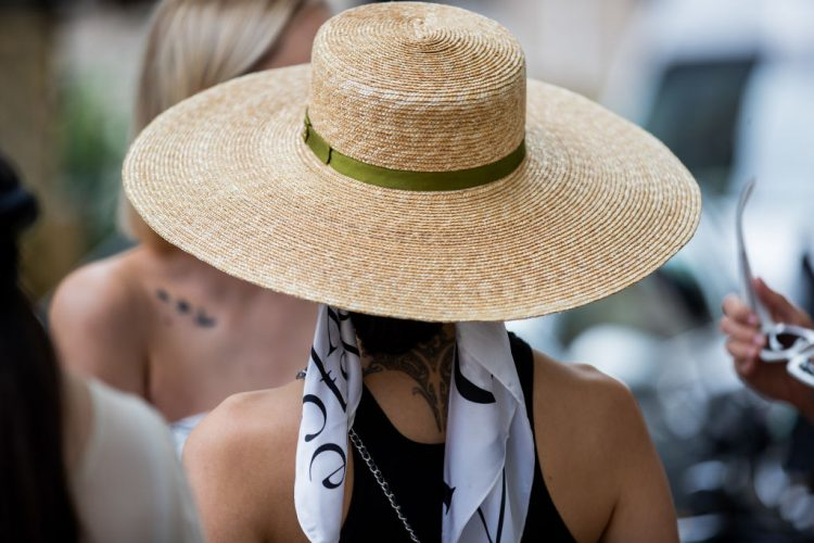 PARIS, FRANCE - JULY 06: A guest is seen wearing Chanel straw hat outside Chanel on July 06, 2021 in Paris, France. (Photo by Christian Vierig/Getty Images)