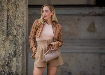 BERLIN, GERMANY - JULY 15: Sonia Lyson is seen wearing total look Fendi First Collection bag, beige shorts, stripped cropped button up top, heels, body, necklace on July 15, 2021 in Berlin, Germany. (Photo by Christian Vierig/Getty Images)