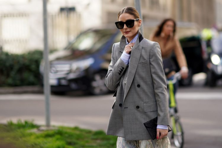 MILAN, ITALY - FEBRUARY 21: Olivia Palermo wears sunglasses, a gray oversized blazer jacket, a blue striped shirt, blue and white striped pants, outside Etro, during Milan Fashion Week Fall/Winter 2020-2021 on February 21, 2020 in Milan, Italy. (Photo by Edward Berthelot/Getty Images)
